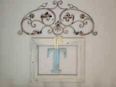 Antiqued wall art above a distressed wooden frame with a painted letter tied to frame with ribbon. Shabby chic decor for above the bed. T loves it! Romantic Cottage, Cottage Chic, House 2, Cozy House, Apt Ideas, House Ideas, Master Bath, Master Bedroom, Window Hinges