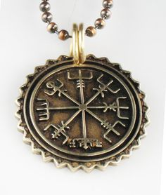 An intriguing bronze Viking pendant, thicker than a quarter coin. This nautical pendant represents Vegvisir, which is an ancient Viking term for direction sign or see the way. This nautical compass helps prevent you from getting lost. It is a brun rune or sea charm. It would make a lovely gift for a Mariner, sailor or nautical person.  This quote sums up my feelings about this design: Brave we were to anchor together under the moonless sky, but we shared this compass and followed those stars…