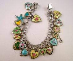 I totally love this!!!!!!!!!!!!!!!!!!!!!!!  Vintage Sterling Silver & Enamel Puffed Repousse Heart Charm Bracelet