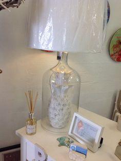 Wooden pineapple under glass lamp
