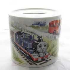 Collectible Thomas the Tank Engine and friends money box by Wedgwood 1980s pottery coin collector ornament has Thomas and his friend Bertie on