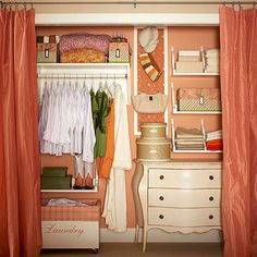 This color-coordinated closet is storage central, decked out with useful accessories. A trio of open shelves along one side places folded items within easy each. Fabric-lined baskets contain everything from bulky linens to delicates. Nestled under the shelving, a small dresser provides valuable drawer space, while a slim bulletin board turns into the perfect spot for hanging hats, scarves, and purses. A shelf surround augments the storage capabilities of a typical rod for hanging clothes.