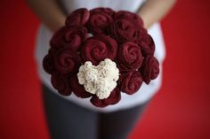 Stella rose is such an irresistibly sweet bouquet. Featuring a deep plummy red wine color, this bouquet has18 budding sola wood flowers along with some extra small natural white wood flowers making up a heart.