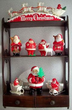 Santa collection  I have all of these from my Momma except the large one on the bottom from the forties, Woolworths or Kresges