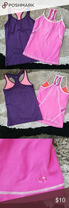 Workout tops Champion (purple) and Air Land Ocean (pink) workout tops.  Cute keyhole and partial mesh back on ALO top.  Gently used in great condition.  Pic 3 shows some of ALO logo rubbed off.  Both are medium but fit like a small. Champion Tops Tank Tops