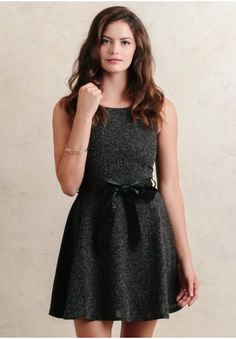This darling dress in charcoal tweed is the perfect addition to any Ruchette's closet this fall! With its fit-and-flare silhouette and faux-leather tie at the waist, this dress is an elegan...