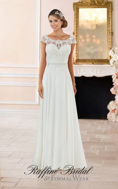 Stella York #6365 - This off the shoulder lace back wedding dress features a mix of classic lace and soft chiffon that was made for walking down the aisle! With a bateau lace neckline, off the shoulder cap sleeves, and simple column silhoutte.
