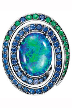 Earrings Aiguebelle, oval cabochon  opal, paved with emeralds and sapphires on white gold by Boucheron