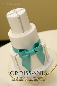 traditional wedding cake; teal bow; BLING!!; by Croissants Bistro & Bakery, Myrtle Beach, SC