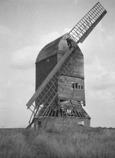 Riseley post mill, near Sharnbrook, Bedfordshire c 1960s. Collapsed in 1971 and only foundations survive. Note that, like Stevington post mill, this is another left hand (clockwise) mill.