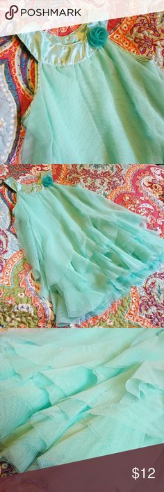 Gauzy Girls Dress Gorgeous gauzy, flowy, sparkly, aqua colored girls dress. Size 4T. This beauty is begging for a little princess to twirl around to her heart's content! Silver sparkles are all throughout, but hard to capture in photos. See 3rd photo for best detail. Dresses Formal