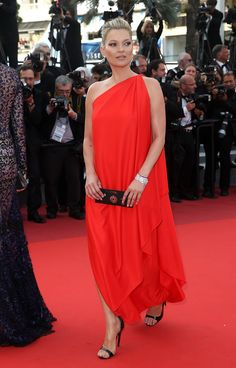16 May Kate Moss made her first appearance of the festival at the premiere of Loving. She wore a one-shouldered red gown with black heeled sandals.   - HarpersBAZAAR.co.uk