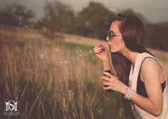 beautiful young woman blowing bubbles in field.  vintage edit.  senior portraits.  high school pictures.  girls hobbies activities.  luxebysm2.com