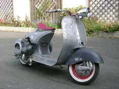Vintage Vespa.  Unpainted?  Love the seat.