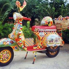 In absence of the more traditional Sicilian Cart, someone thought a sicilian Vespa would do just as well...