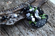 Black and white polymer clay flower by Zubiju