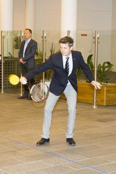 Crown Prince Frederik dusts off his tennis skills when playing against four youngsters in Copenhagen.