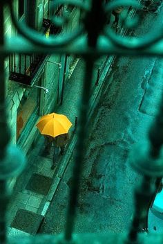 """""""Once upon a time, a girl walked upon a road on a rainy day, her yellow umbrella standing out among the darkened city. Street Photography, Art Photography, Umbrella Photography, Foto Picture, Zoom Photo, Yellow Umbrella, Umbrella Art, Parasols, Love Rain"""