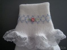 Smocked socks. A few pairs of these and I'll be more willing to cover up Lindys painted toesies!