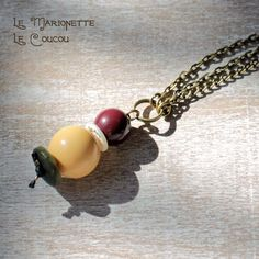 Antique brass bracelet with light yellow marionette pendant by LeCoucouDesign on Etsy