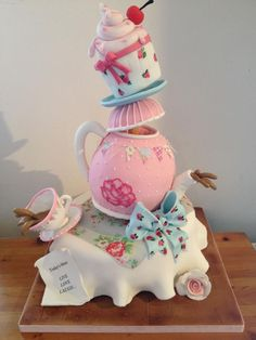 What's not to love about a cake with SO much design potential? There are endless ways to decorate a teapot cake, florals, handpaintings, they can even be transformed into a show-stopping gravity defying maserpiece! Pretty Cakes, Cute Cakes, Beautiful Cakes, Amazing Cakes, Gravity Defying Cake, Gravity Cake, Crazy Cakes, Fancy Cakes, Unique Cakes