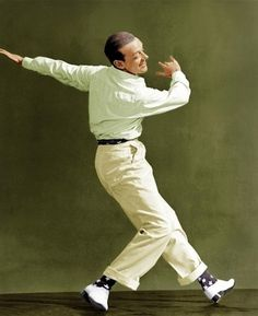 Fred Astaire; cream flannel trousers, navy patterned socks, white buckskin derby shoes