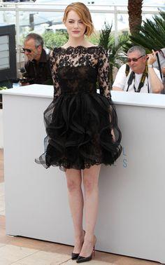 Emma Stone wears a black lace Oscar de la Renta Pre-Fall '15 dress and Louboutin heels