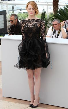Emma Stone wears a black lace Oscar de la Renta Pre-Fall '15 dress and Louboutin heels