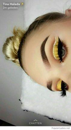 Amazing yellow eye makeup and bonde hair