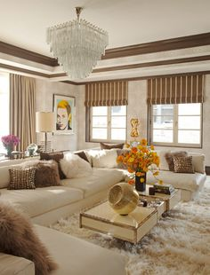 Get the Look of This Glamorous Living Room: Elegant ivory walls, an ivory leather sofa, and a beautiful trunk-inspired coffee table create a neutral, polished backdrop for the room's glamorous accents.  Photo courtesy of Martyn Lawrence Bullard Design