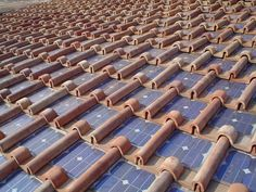 roof tiles with solar panels! Great idea! And they look soooo much nicer!