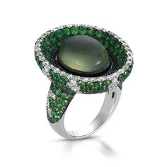 VannaK.com 18 Karat Gold -Captain Cook first hand carried this mystique, mint green & rare gemstone from the cook islands .... (Phrenite) 10.39 carats- Hand Set in 18 karat gold, 1.85 TCW Diamonds and 7 carats of Tsavorite garnets are micro-paved to create a spectacular Fashion forward Statement!