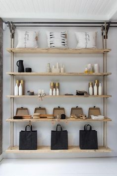Rope Hanging Shelves ~ sanded scaffolding boards and rope held by metal curtain rods (DIY Possibility) | interior designer Danielle Reid for Folklore