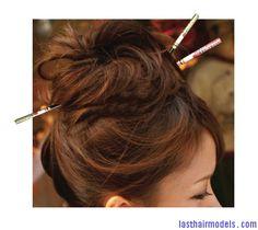 messy bun with chopsticks