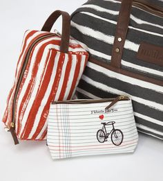 """""""I Wheelie Like You"""" pouch and bags from MAIKA. Made of recycled canvas and printed with eco-friendly pigment inks. Features waterproof lining and vegan leather trim.  7.5"""" x 5"""" x 2.5"""""""