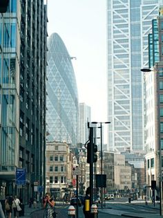 At the southern end of East London, the skyline takes a sudden leap, propelled by the riches of the financial district.