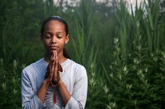 God will not hear you if you are a sinner, but only when you are calling for repentance. Teenage girl praying outdoors at twilight. Shallow DOF.