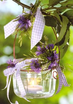 Very cute DIY idea for a summer party. Get a mason jar, deck it out in appropriate flowers and ribbons, then fill it with a Candle Impressions Flameless Tea Light or Votive so you don't need to worry about fire!