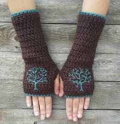 Warm and cozy arm warmers crocheted with soft acrylic yarn in dark chocolate brown with embroidered tree design in teal wool. These arm warmers are fitted but will allow for some stretch. They measure about around the top of the forearm 9 long. Fingerless Gloves Crochet Pattern, Fingerless Gloves Knitted, Hand Crochet, Crochet Hats, Crochet Arm Warmers, Wool Gloves, Crotchet Patterns, Wool Yarn, Knitting