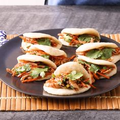 Healthy Dinner Recipes Discover Easy Shortcut Steamed Bao Buns Making these steamed bao buns is much easier than you think! Start with refrigerated biscuit dough to speed the process along then whip up the filling and steam. Steam Buns Recipe, Bun Recipe, Steam Recipes, Steamed Bao Buns, Steamed Food, Pork Recipes, Cooking Recipes, Korean Food Recipes, Gastronomia
