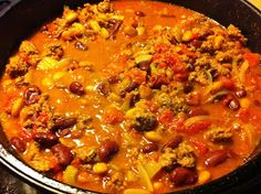 Dutch oven chili simmering on the stove   This is an easy-to-make chili that'll make you feel like a cast iron pro. You can use your cast ...