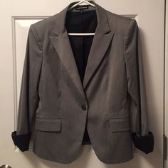 Gray Tailored Blazer Fantastic grey blazer- great for work! Size 10 from Express. Small shoulder pads make for a timeless style. Inside is black silk material. Fits true to size, great functional front pockets. Like-new condition! Express Jackets & Coats Blazers