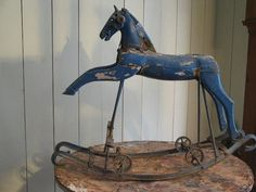 French rocking horse with iron head. Old blue paint. Rare model. Circa 1900.: