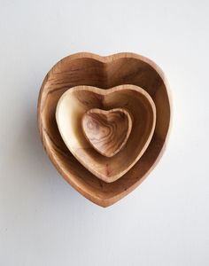 these beautiful heart bowls are hand-carved from wild olive wood
