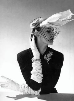 1951. Hat by Jacques Fath.  Photo by Willy Maywald (B1907-D1985)
