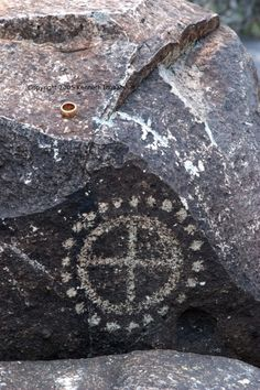 Three Rivers National Historic Park:  petroglyph of a + in a circle surrounded by dots