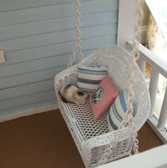 Where can I find a swing like this? - look, there's a CAT on the swing! - many more porch pictures here