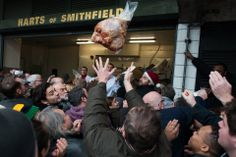 MEAT SALE: Members of Harts the Butchers sell off surplus meats during the annual Christmas Eve meat auction at London's Smithfield Meat Market. (Peter Kollanyi/i-Images/Zuma Press)