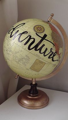 Hand painted globe. Unique designs and phrases perfect gift for those who love to travel.