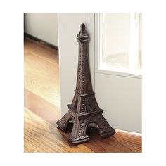 I love Eiffel Towers-this doorstop is great, and would make a fabulous bookend, too  www.ballarddesigns.com